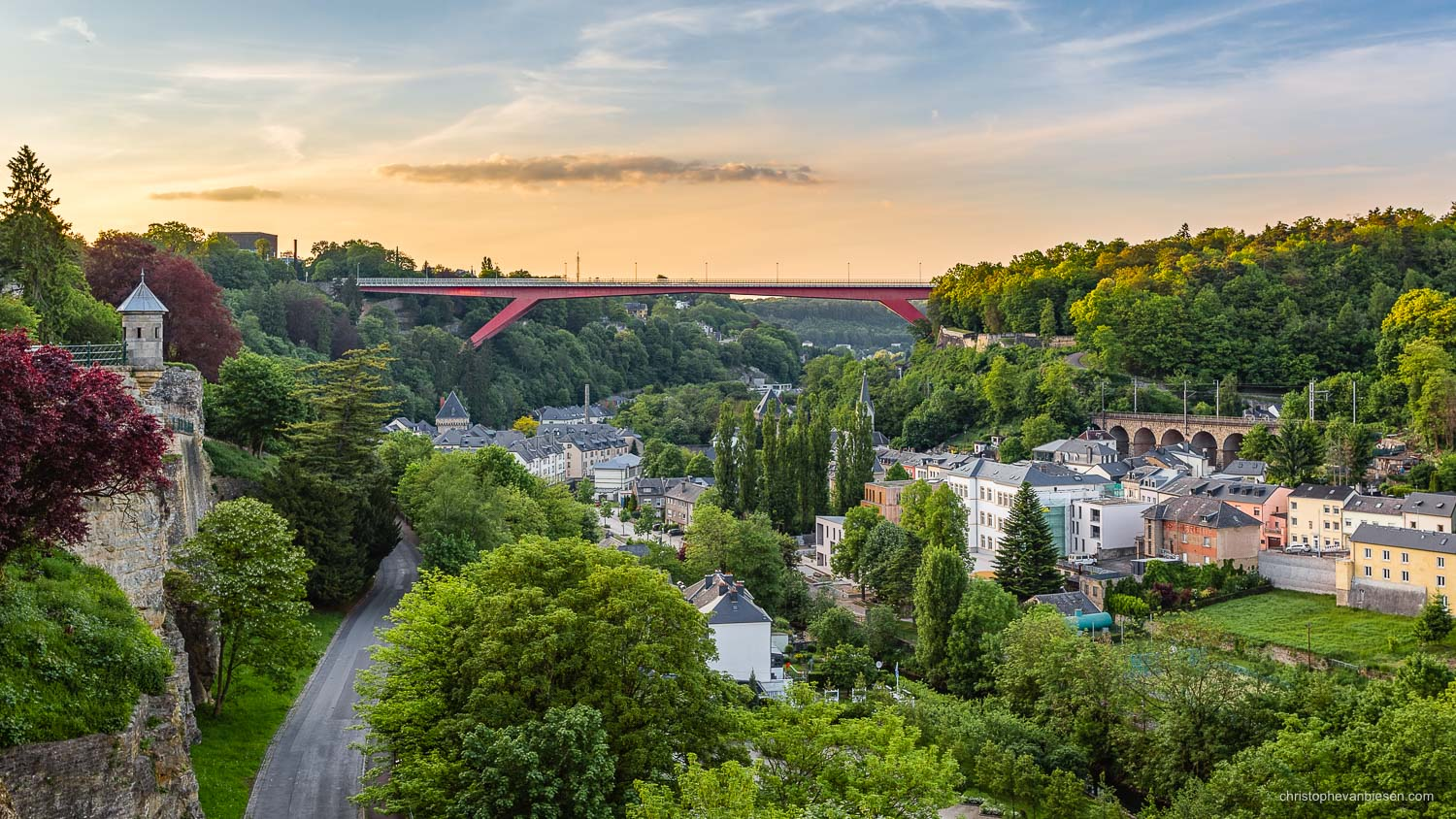 Summer in Luxembourg - Sunset over Luxembourg's Pfaffenthal with its Grand Duchess Charlotte Bridge, aka the Red Bridge, and its Spanish Towers - Le Pont Rouge