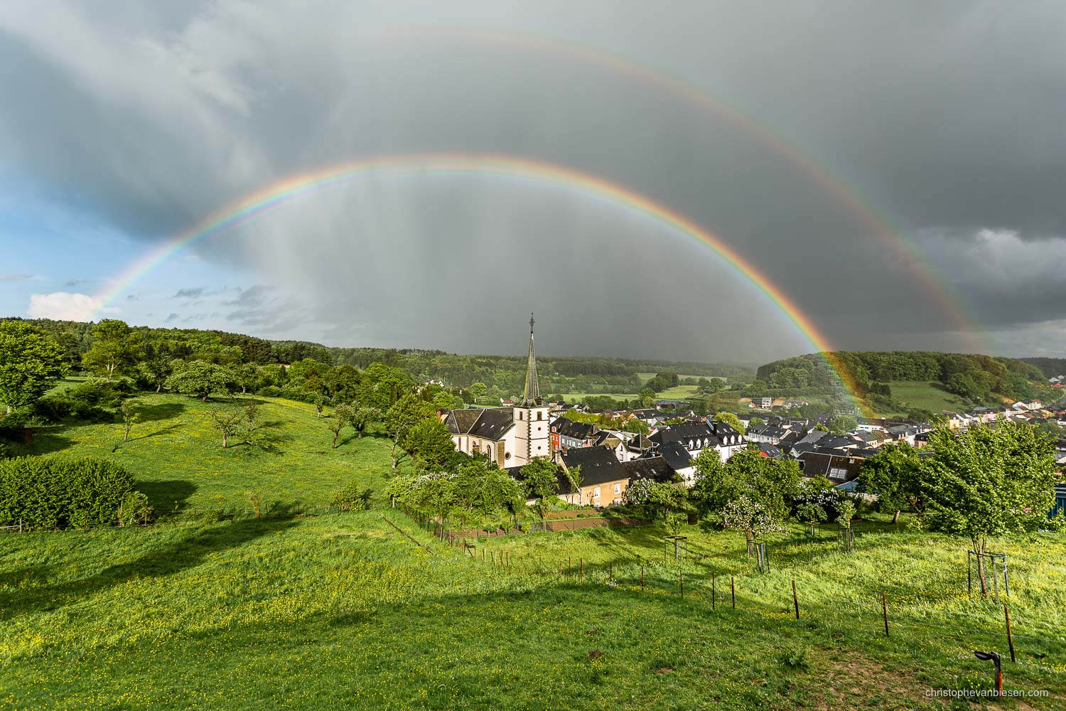 Spring in Luxembourg - Perfect rainbow above the Luxemburgish village of Hobscheid - Where Blue Birds Fly