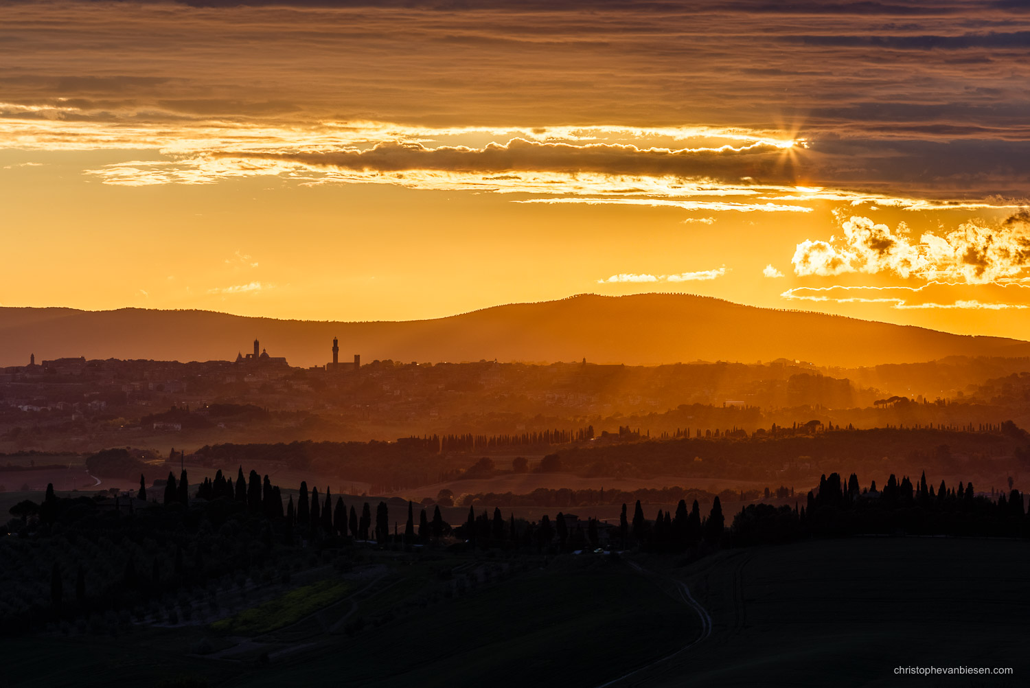 Tuscany - Italy - The city of Siena seen from the Crete Senesi during sunset - Sunset over Siena