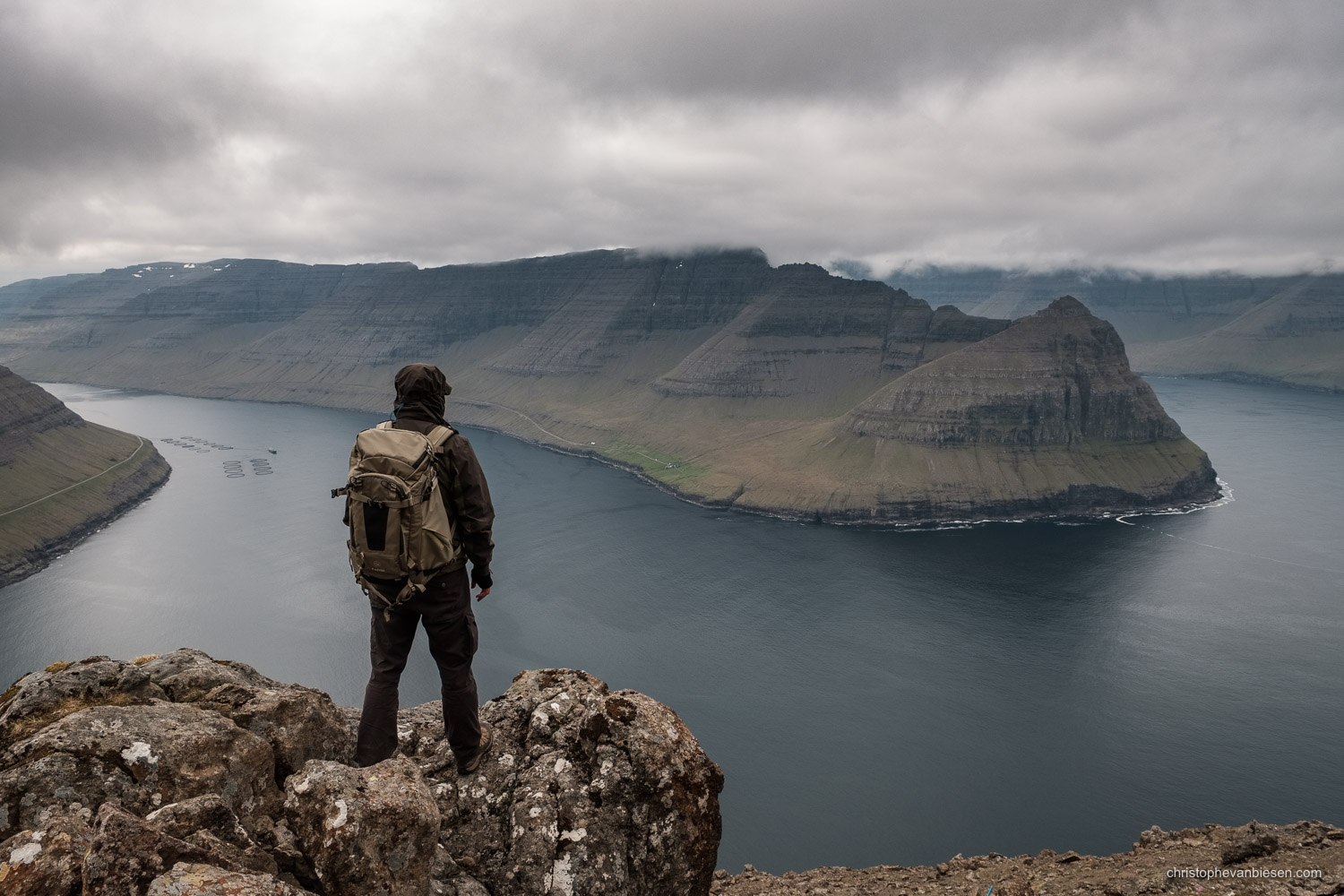 Vidoy - Faroe Islands - Traveller looking at the northern fjords in the Faroe Islands - Above the Fjords
