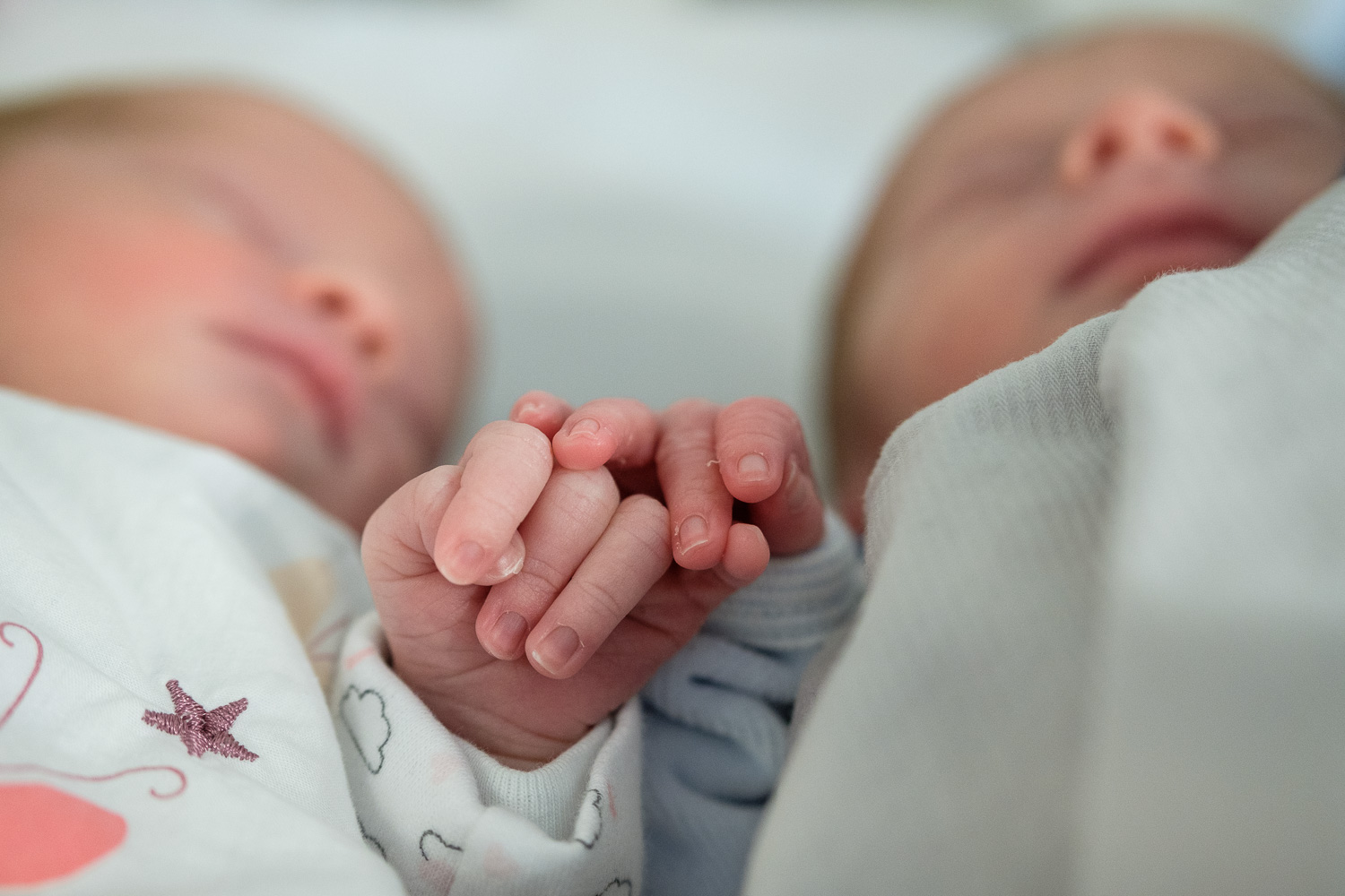 Twins holding hands