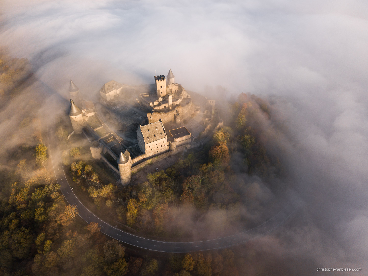 Bourscheid Castle in the fog - Chateau de Bourscheid - Luxembourg - Drone - Bourscheid Castle amidst autumn fog seen from the air - Ethereal Shores