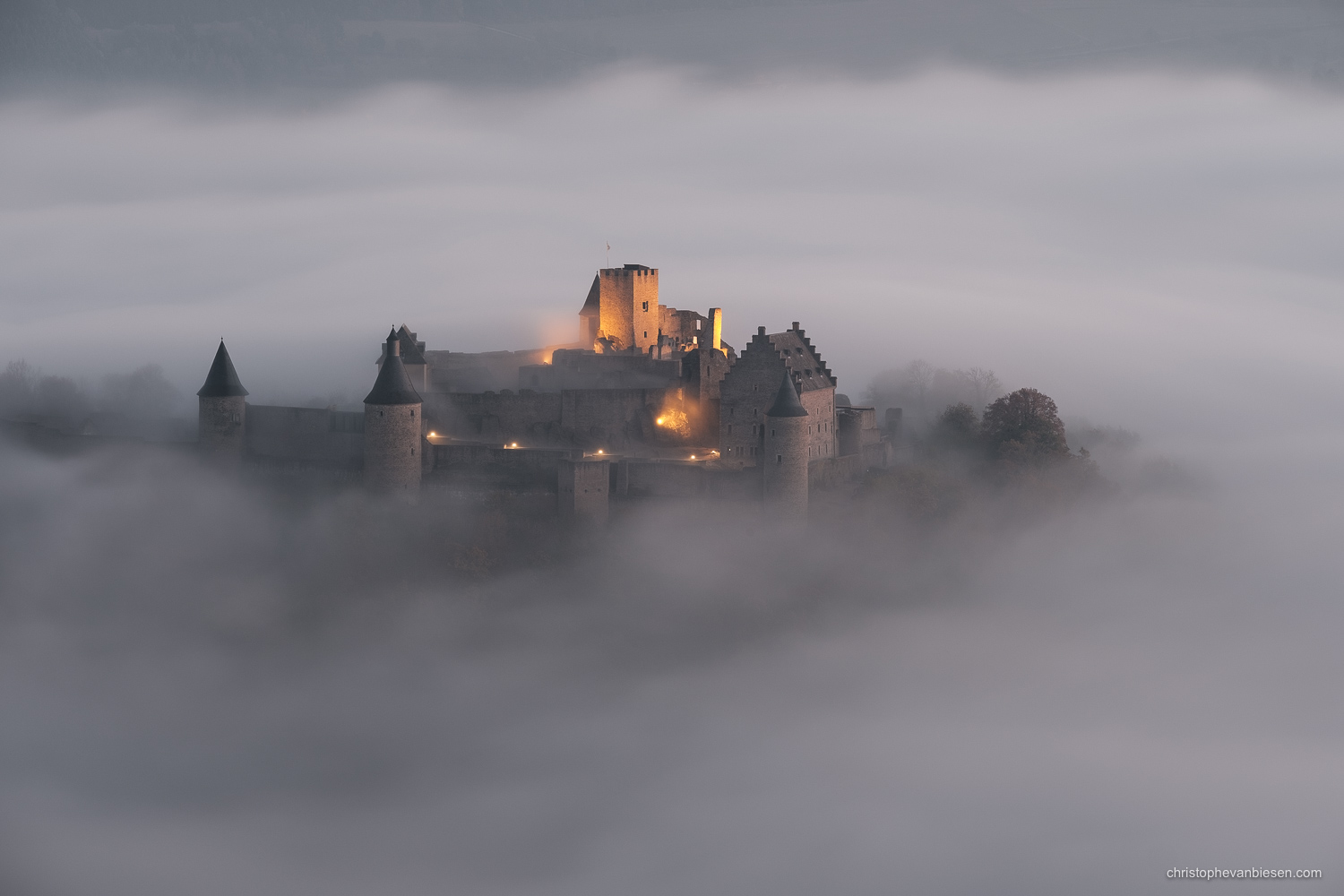 Bourscheid Castle in the fog - Chateau de Bourscheid - Luxembourg - Bourscheid Castle at night emerging from the fog - Veiled by Shadows and Fog