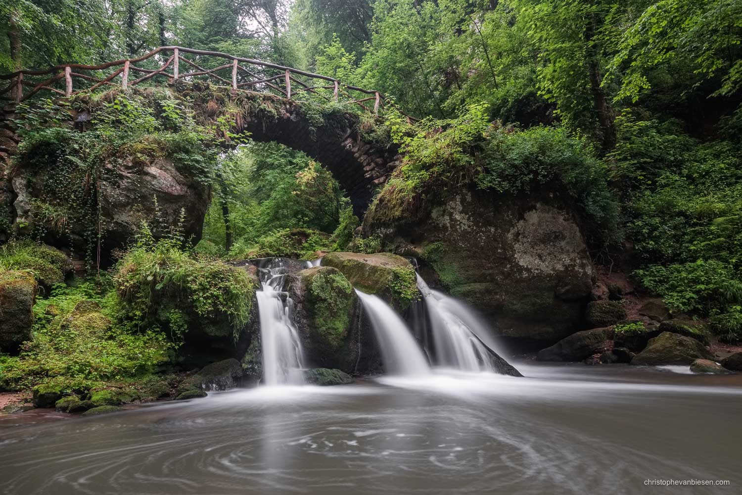 Visit the Mullerthal - Luxembourg - Luxembourg's Schiessentumpel waterfall in the Mullerthal region on a rainy summer day - Home of the Elves