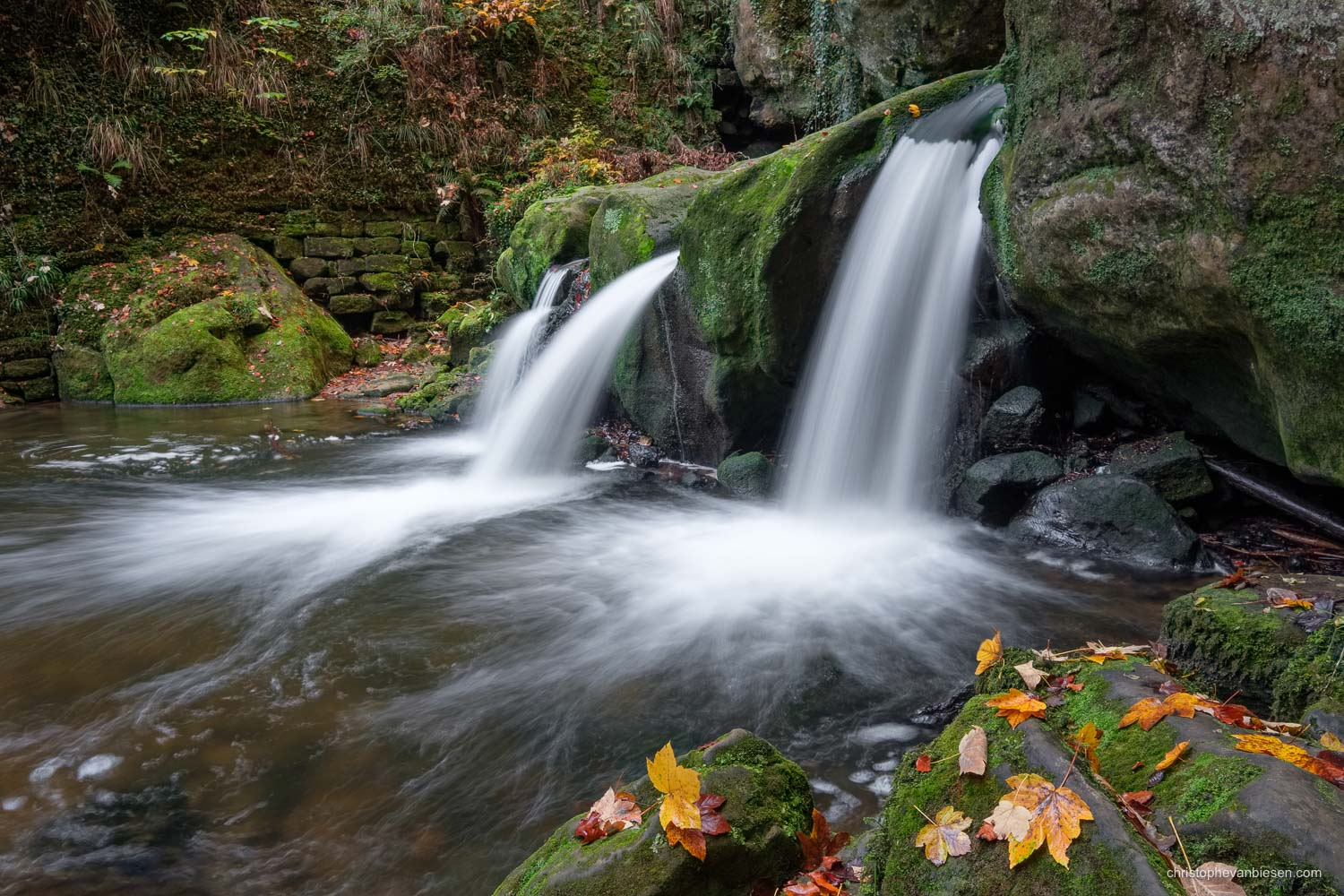 Visit the Mullerthal - Luxembourg - Fall at the Mullerthal's Schiessentumpel waterfall - Roaring Waters