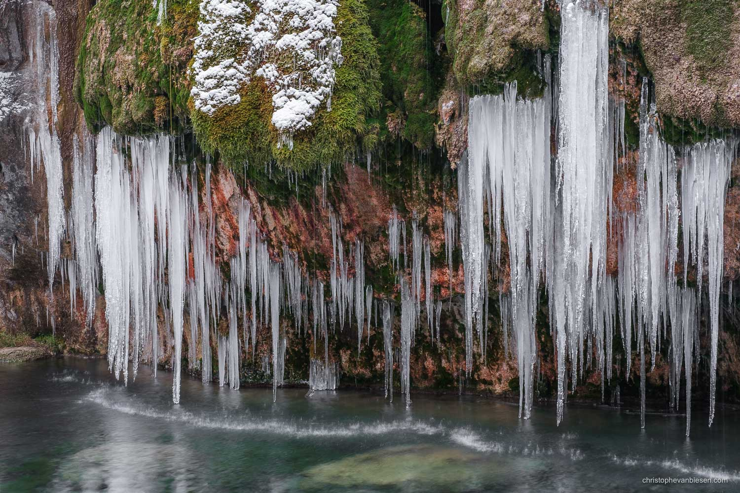 Visit the Mullerthal - Luxembourg - Frozen waterfall in Luxembourg's Mullerthal region during a very cold winter - Melting Cascade