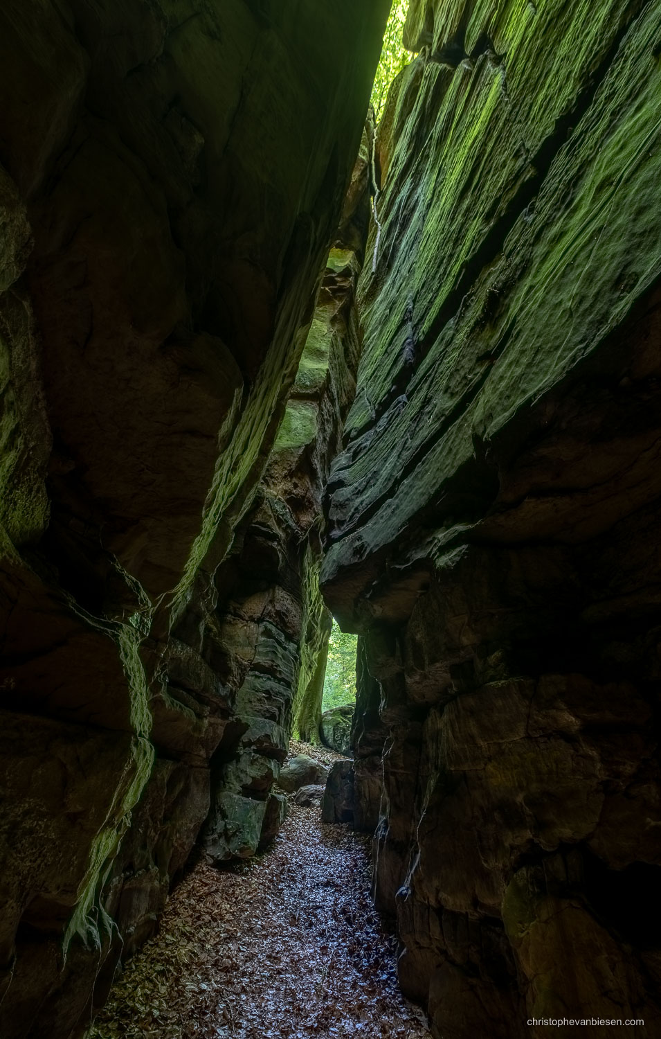 Visit the Mullerthal - Luxembourg - Narrow passage in the Mullerthal's Goldfralay caves in eastern Luxembourg - Green Canyon
