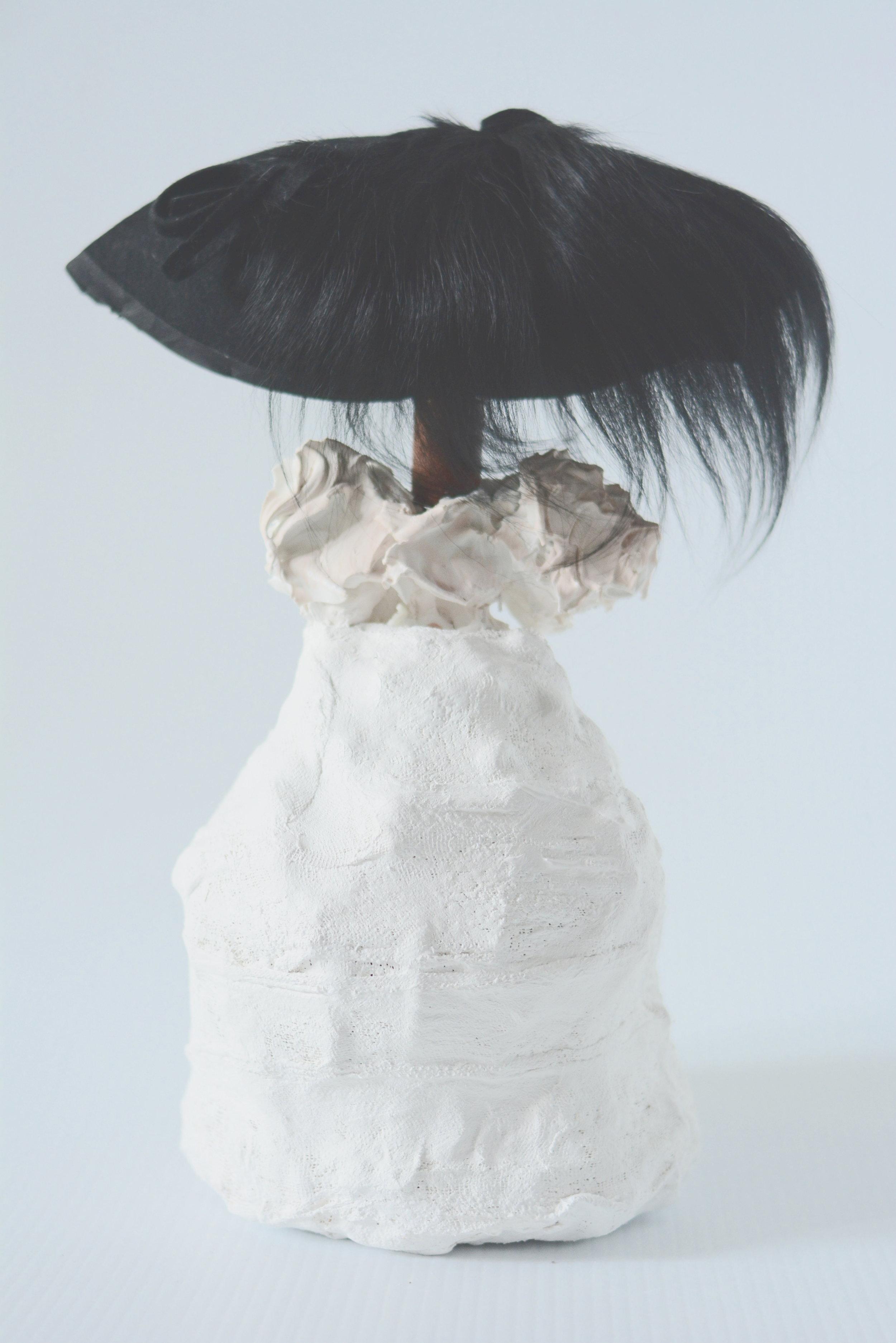 Maryam Keyhani, Safe Under My Heart_Epoxy,Plaster, foam, paint, vintafe hat_38x28x20cm.JPG