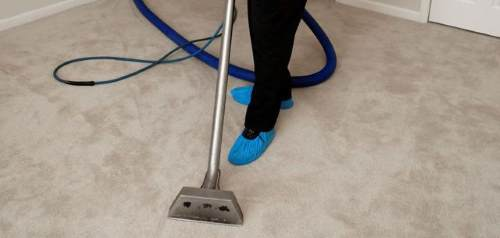 Floor cleaning by a worker-500x238.jpg