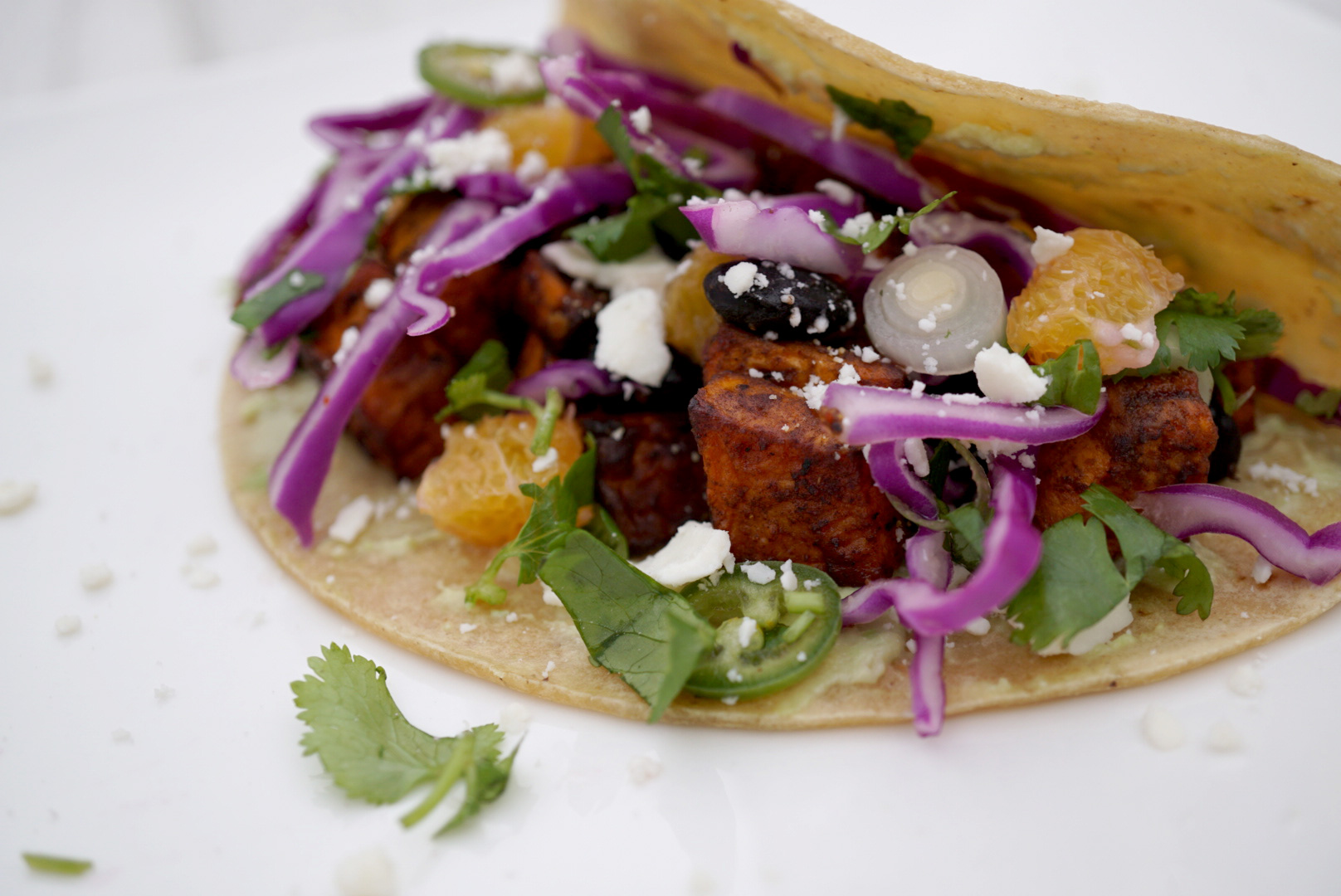 Sweet Potato Taco - with añejo, black beans and seasonal toppings