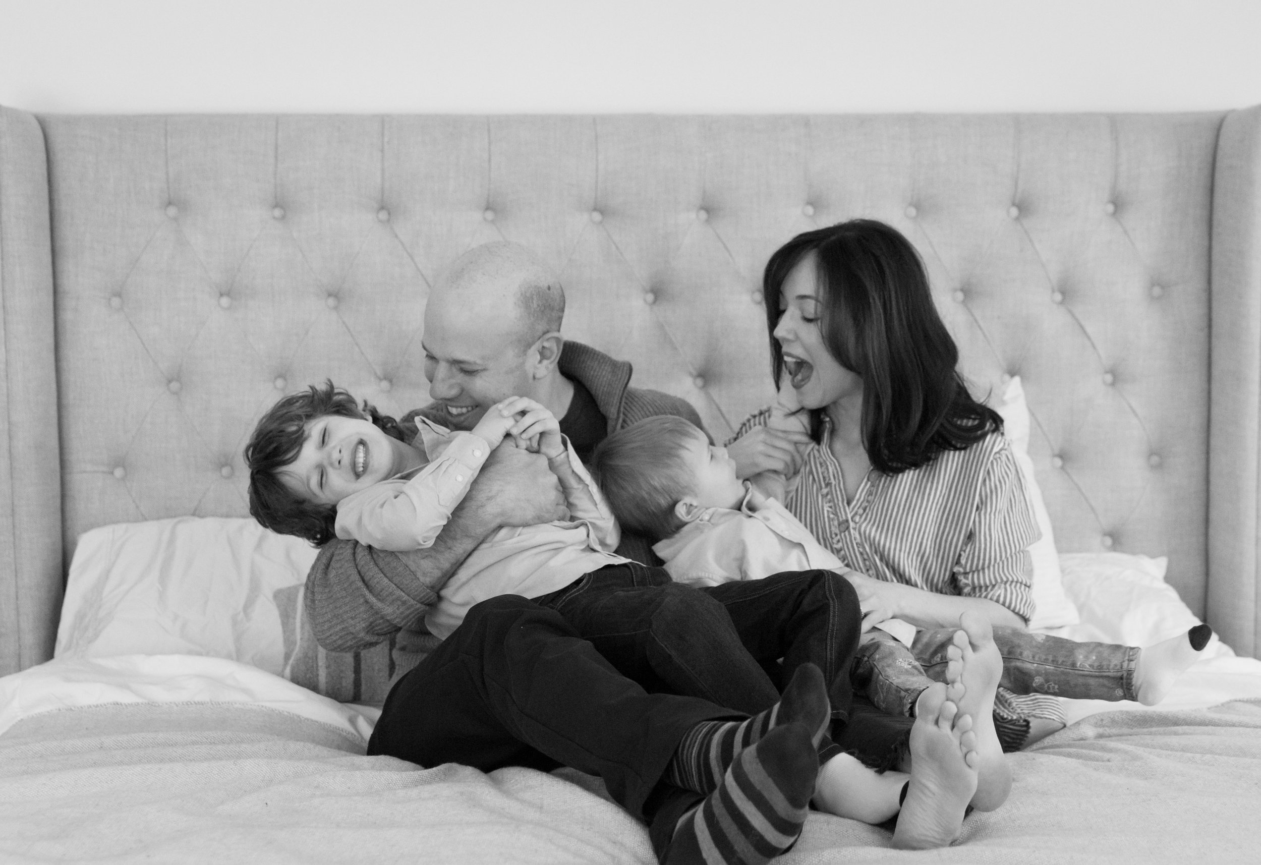 New York Family Photograher Helene Stype_ happy family on bed with toddler.jpeg