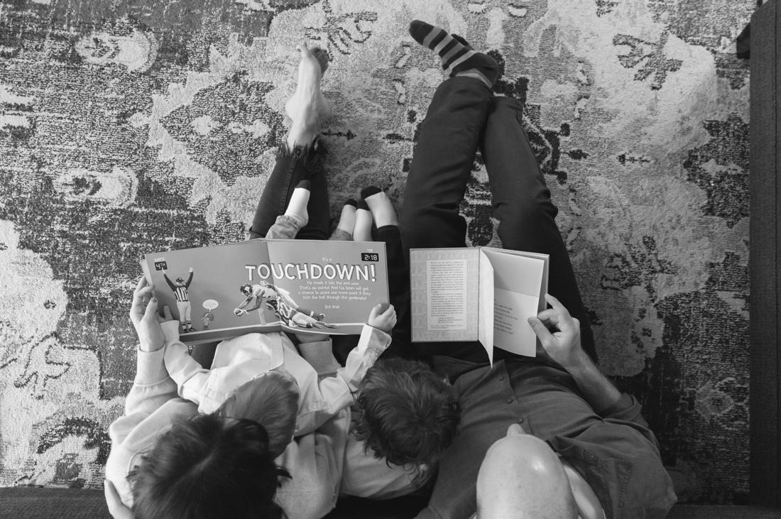 In home family session reading a book New York Family Photographer Helene Stype 0419-13.jpg