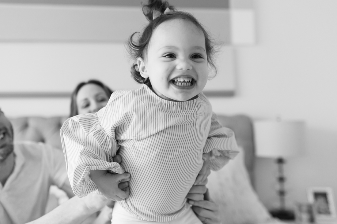 Toddler smiling during in home session in lower Manhattan