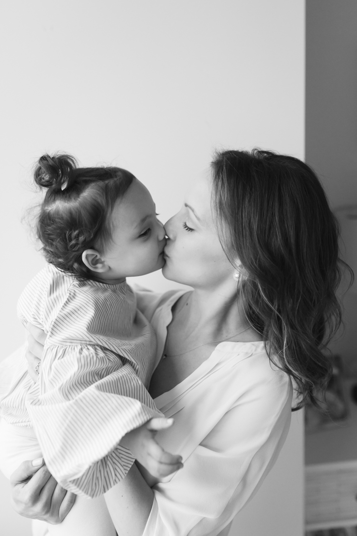 Mother giving a kiss to her daughter
