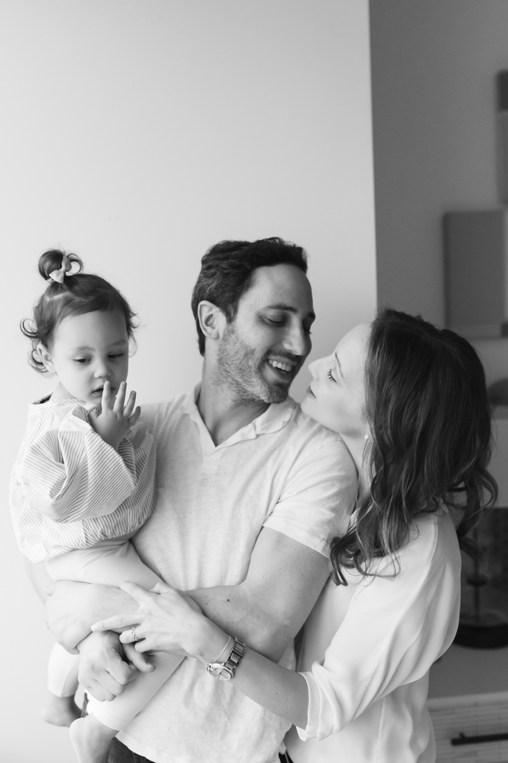 Family of three during an in-home photo session