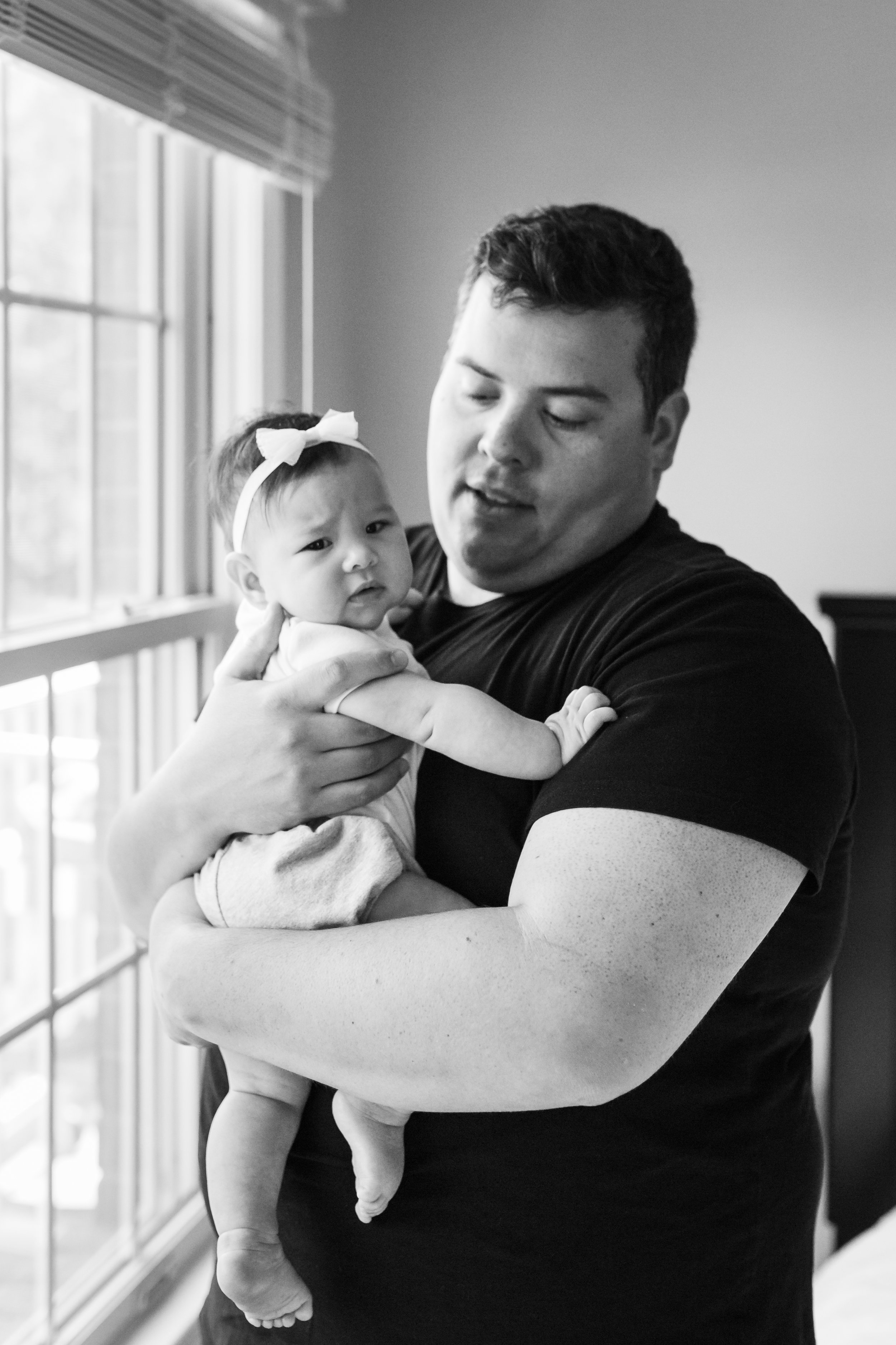 Black and white photograph of 4 months old baby girl during an at home family session in NJ