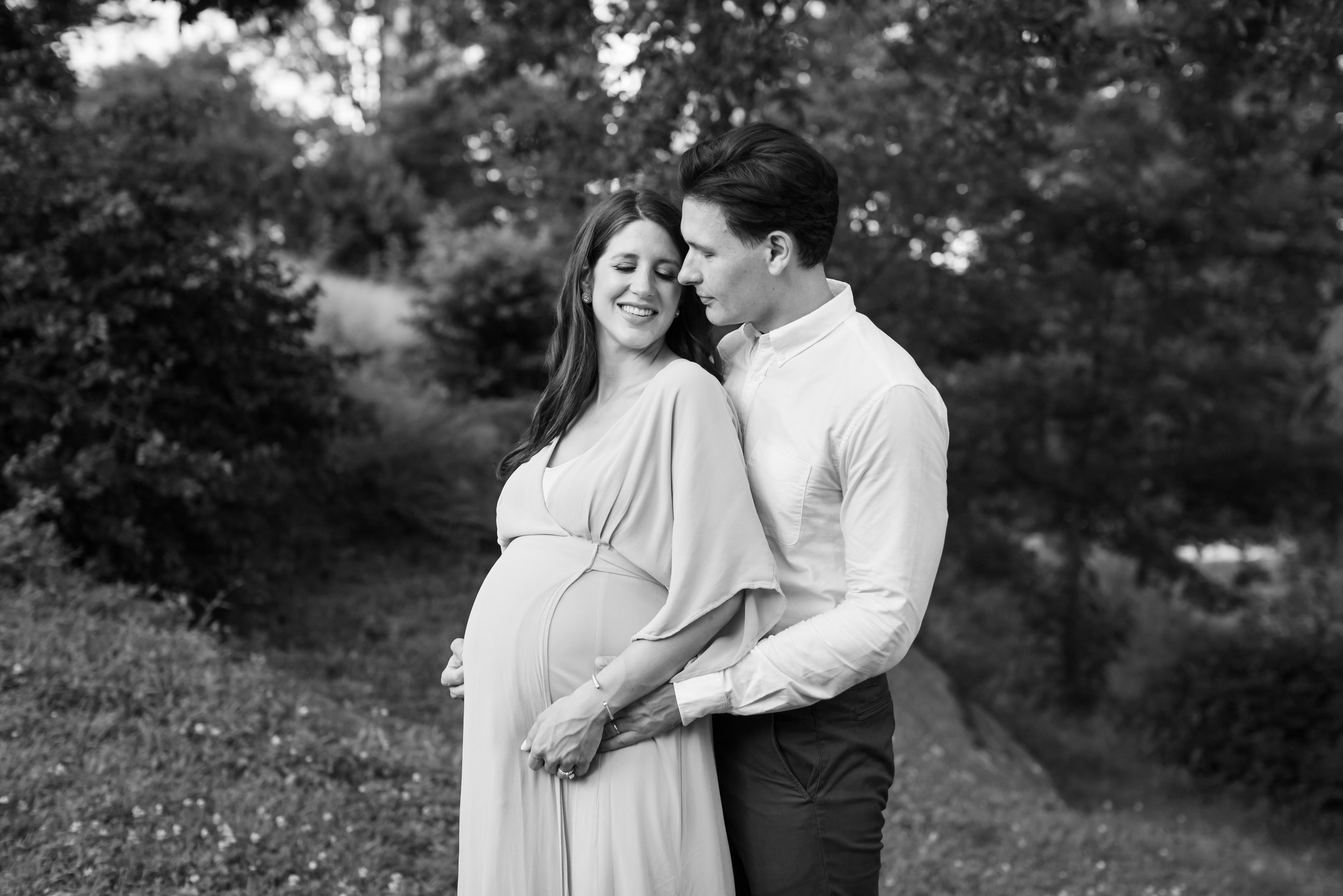 Central Park black and white maternity session by Helene Stype - couple holding hands and looking at each other