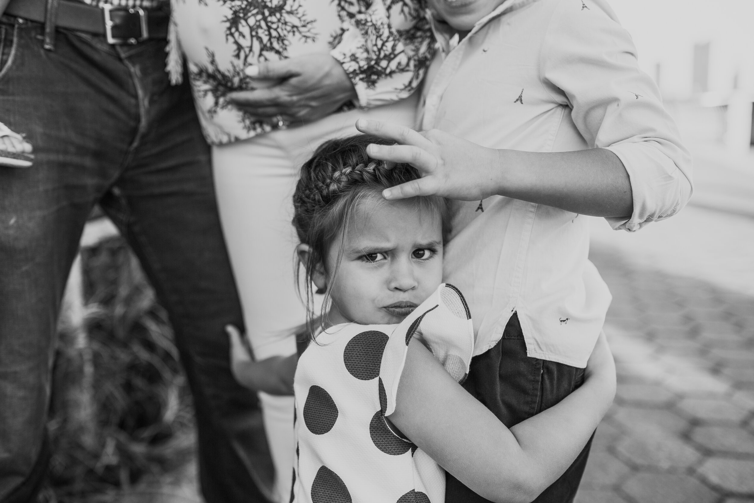 Little girl hugging her brother and pregnant mother during a maternity session in tribeca