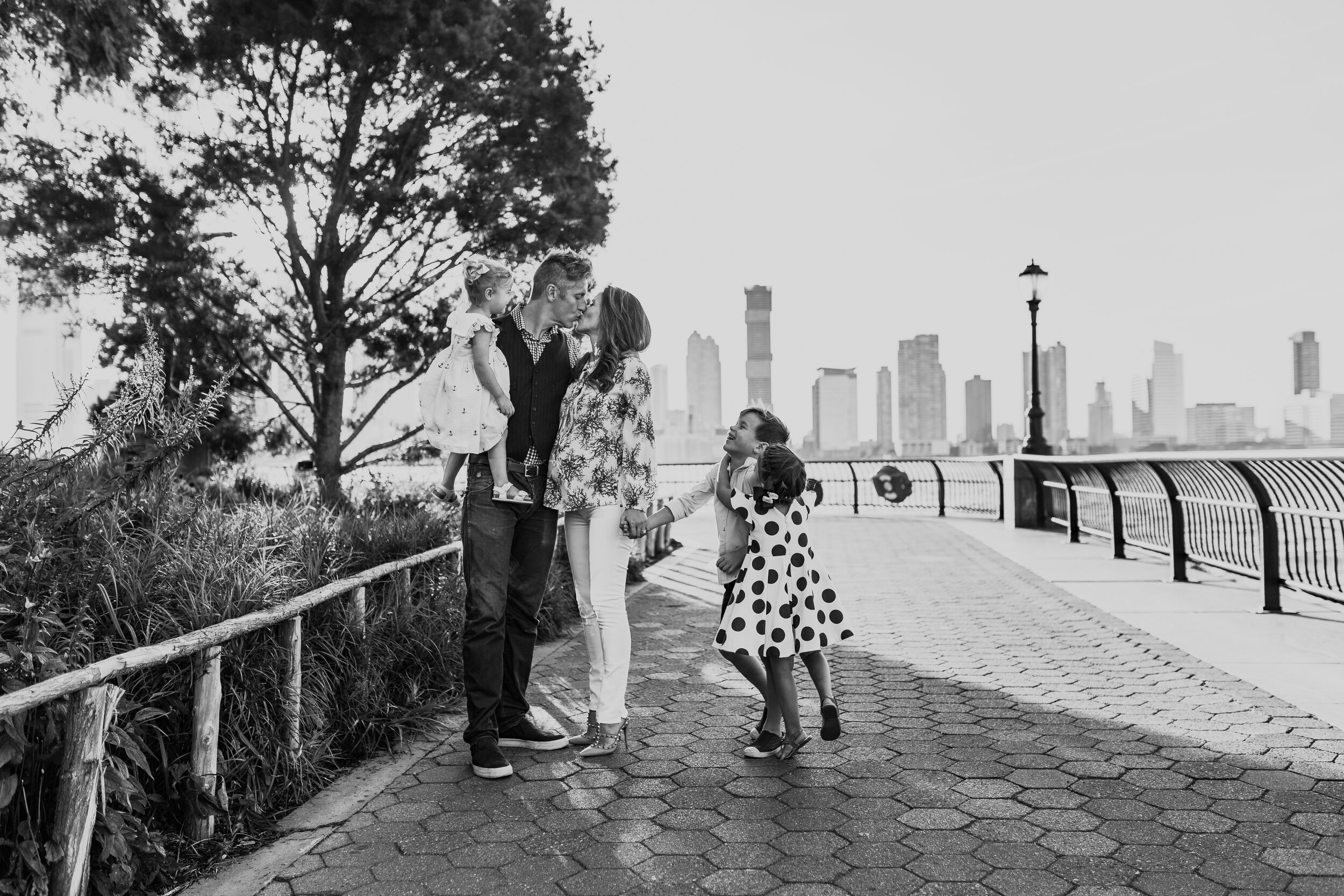 Family portrait holding hands during a family session in Battery Park City