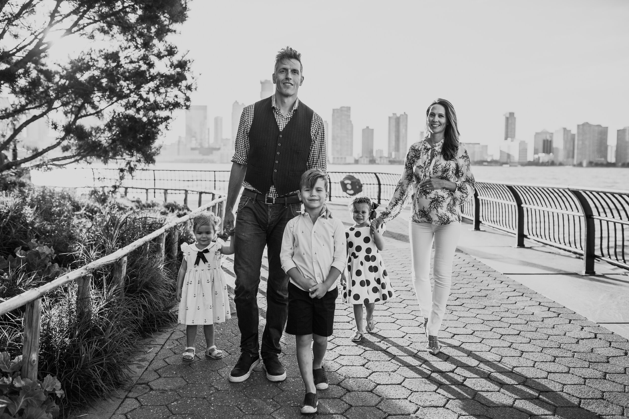 Black and white portrait of a family three children and pregnant mother during a maternity photography session in battery park city new york