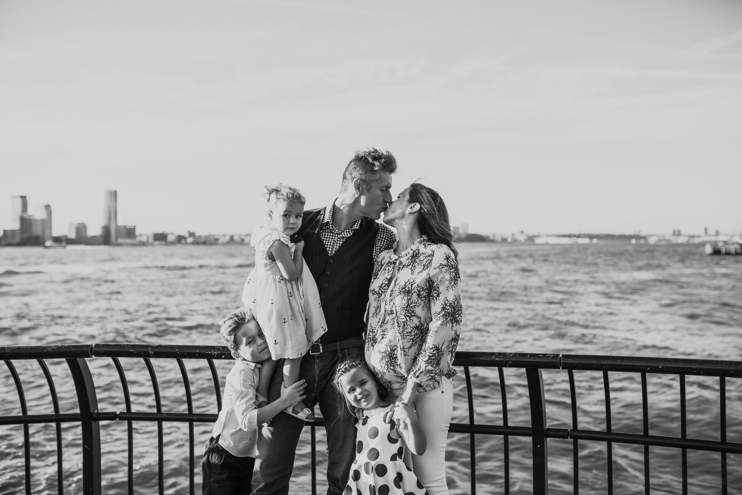 Portrait of a family of 5 expecting their fourth child in manhattan during a family photo shoot