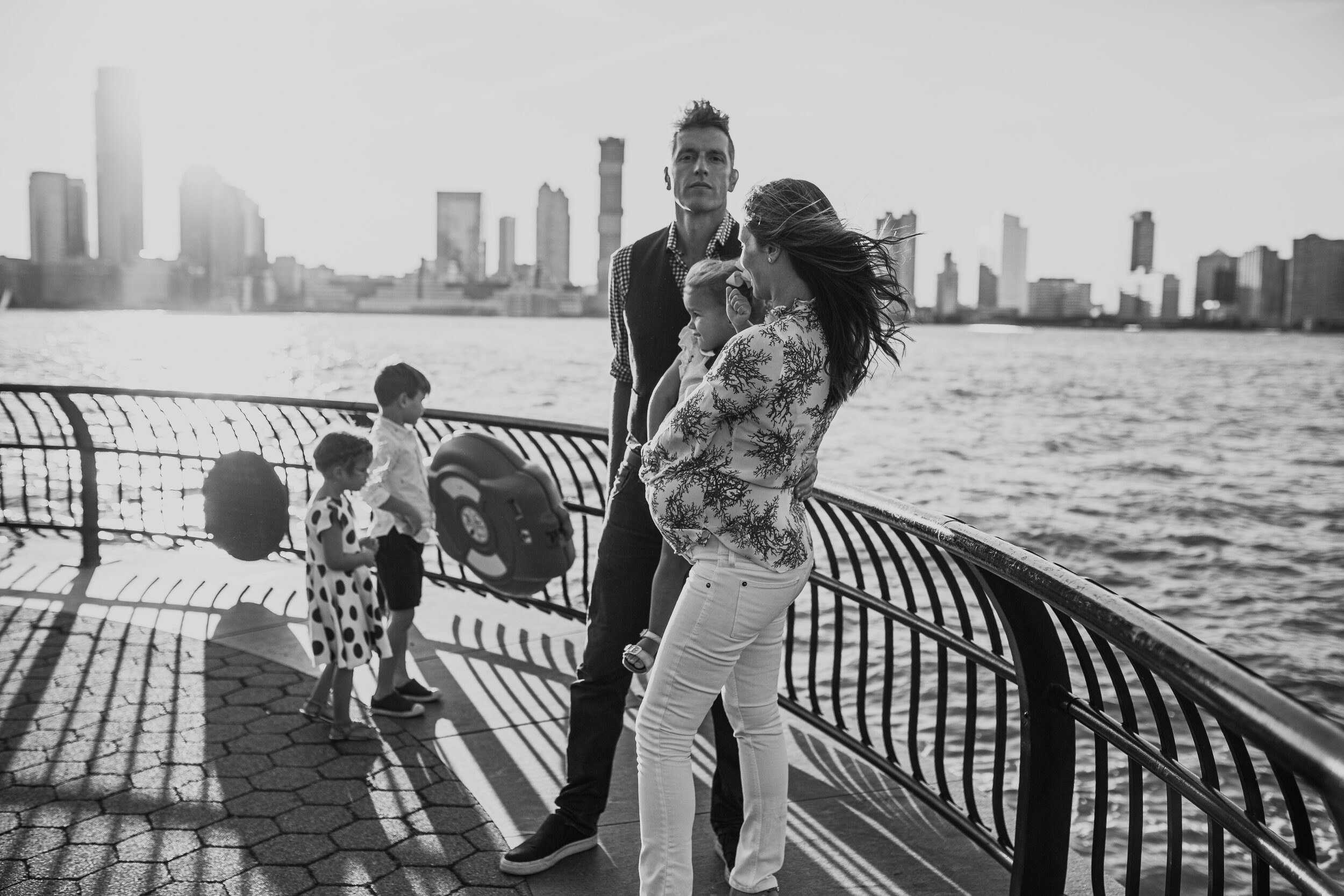 Portrait of a family expecting their fourth during a maternity photography session in Manhattan