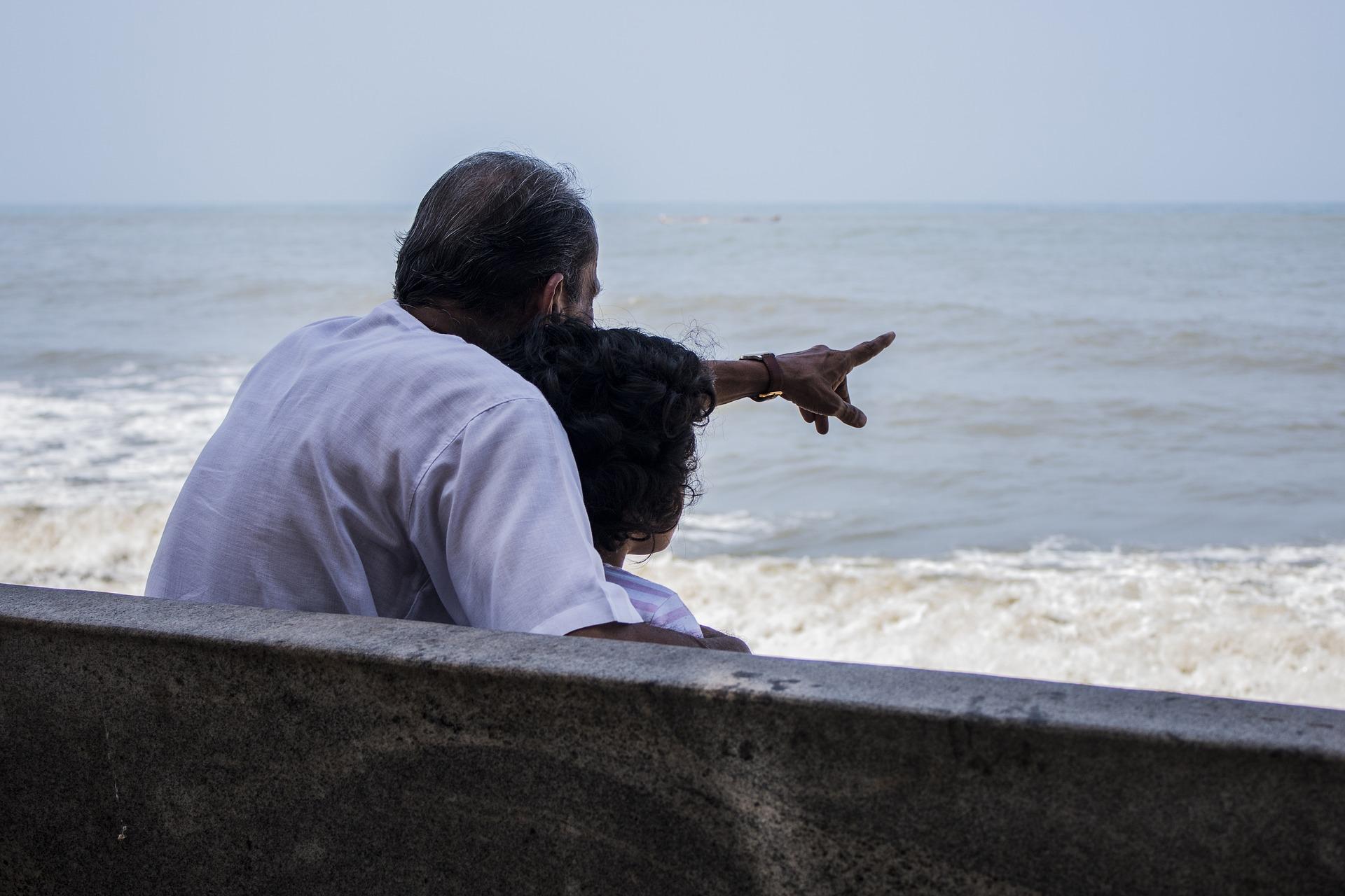 grandfather-with-grandchild-at-beach.jpg