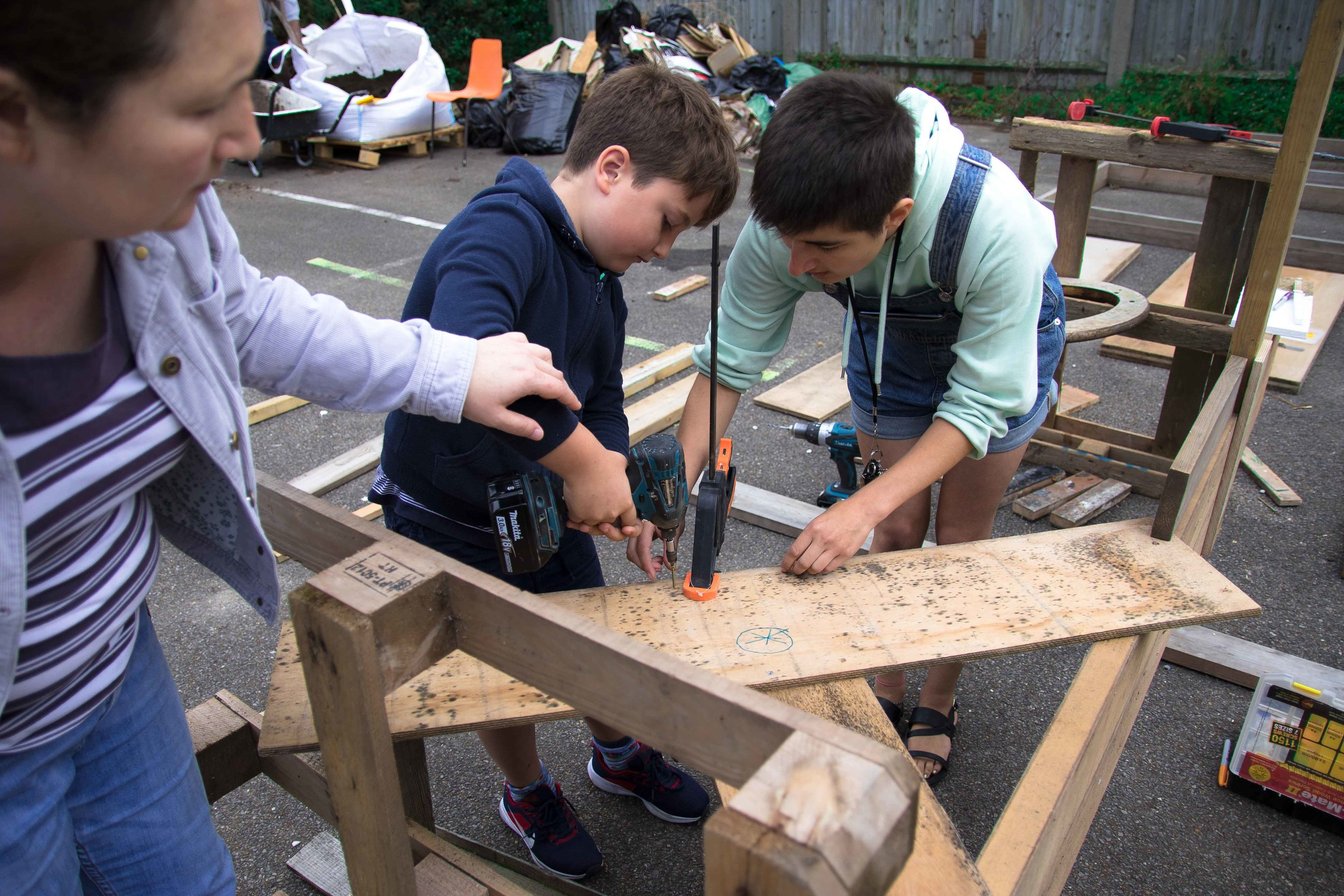 A child building a structure at the Beacon Garden Workshop at The White House