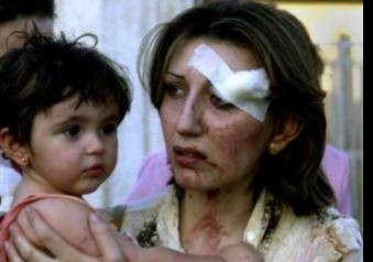 Mother-and-child-after-Christian-Church-Bombing-e1317518582608.jpg