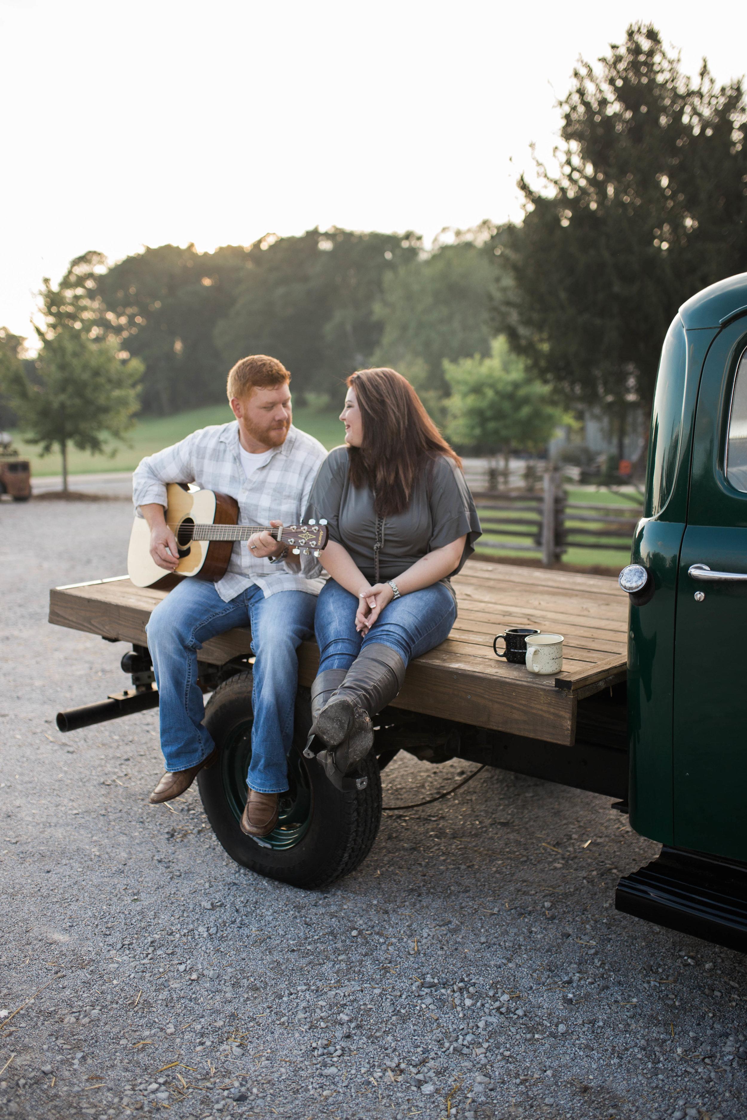 Groom to be playing guitar | Engagement Session | Cedar Creek Nursery | Montevallo, AL