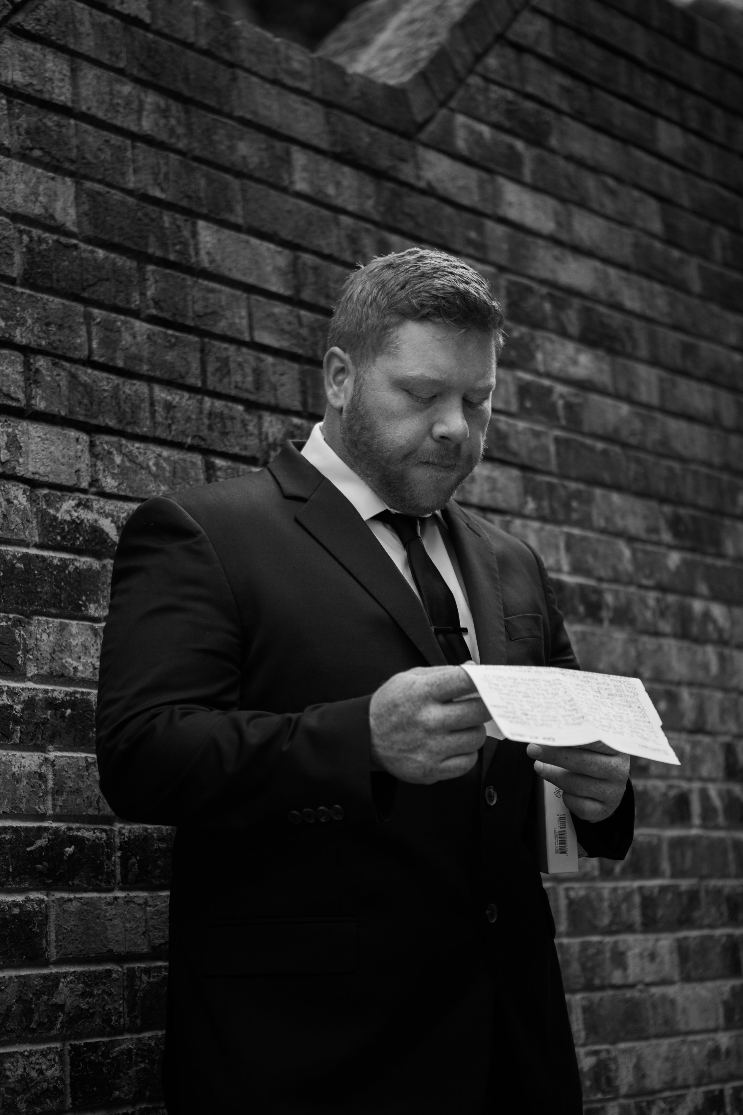 Groom reading letter | Smith Lake Wedding