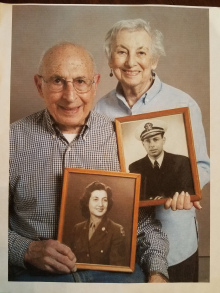 Gloria and Gene, holding each other's military portraits
