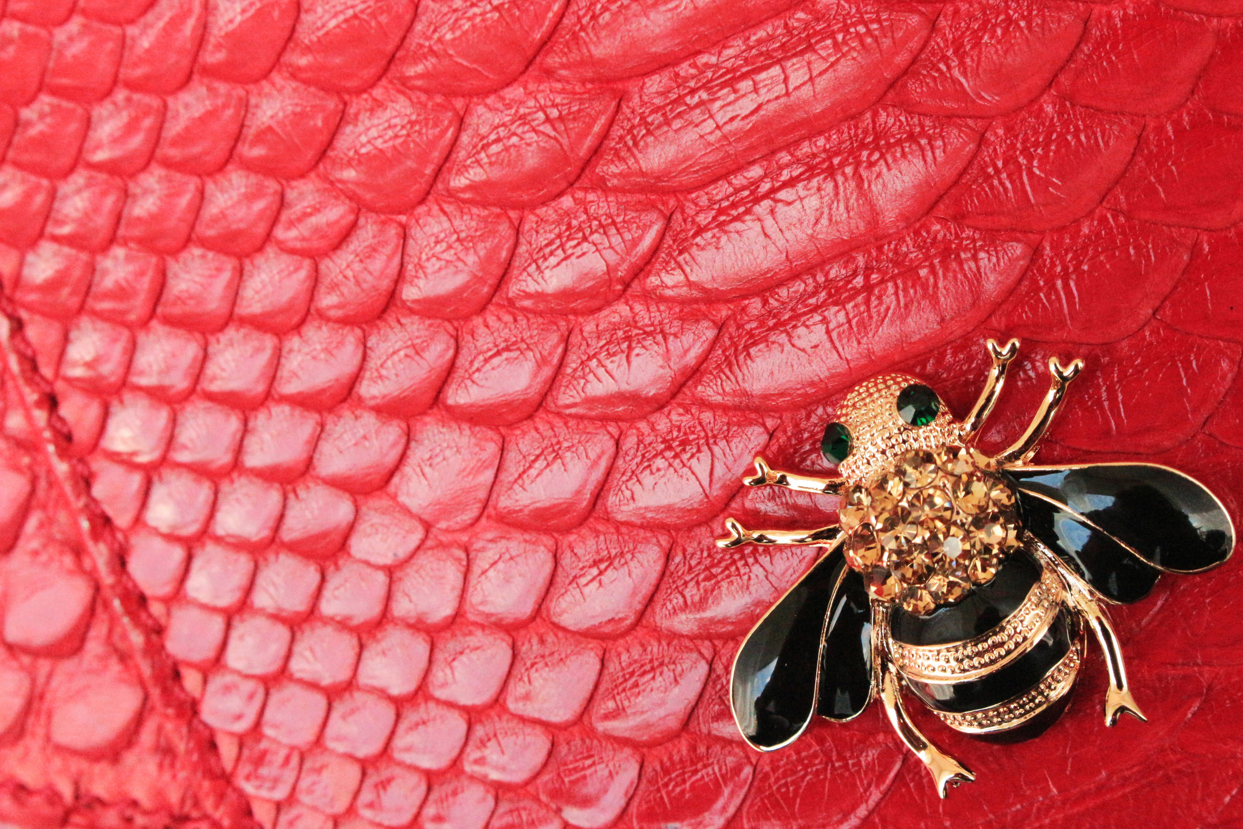 Red python skin pattern with bee jewel