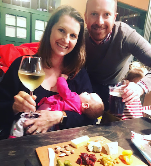 A hard-earned glass of wine during our first dinner out as a family of six.