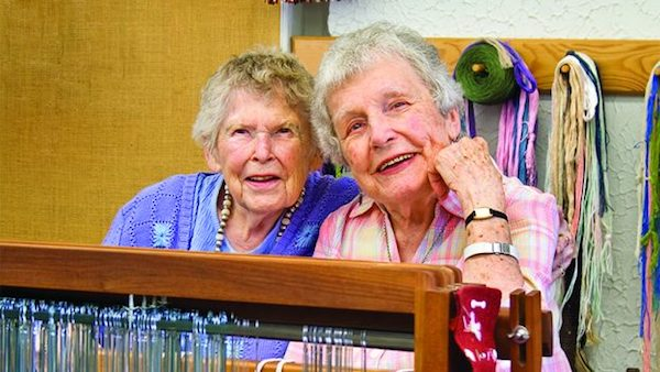 "A recent photo of my grandma, age 99, featured in her local paper, along with her long-time friend and fellow 99-year-old, as they reflect on their time as ""Grand Weavers"" at the Tryon Arts and Crafts School. Photo: Tryon Daily Bulletin."