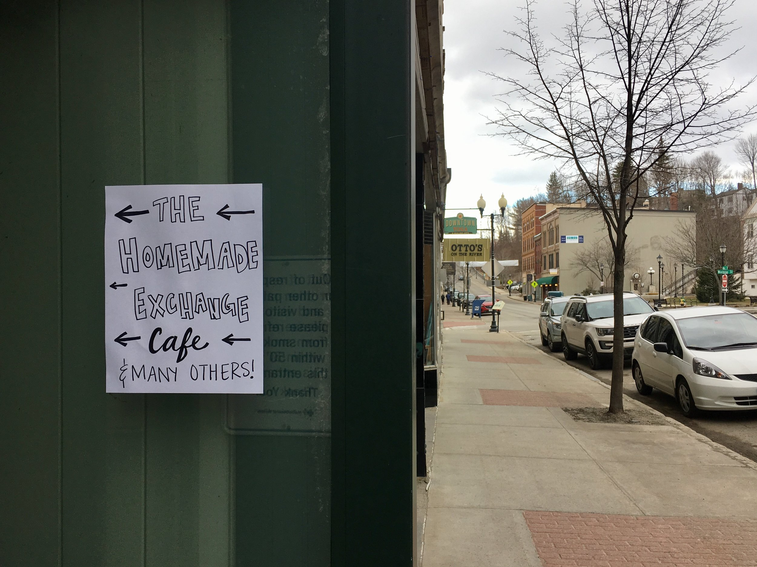 Our handwritten sign posted to direct folks walking down Water Street into our pop-up cafe.
