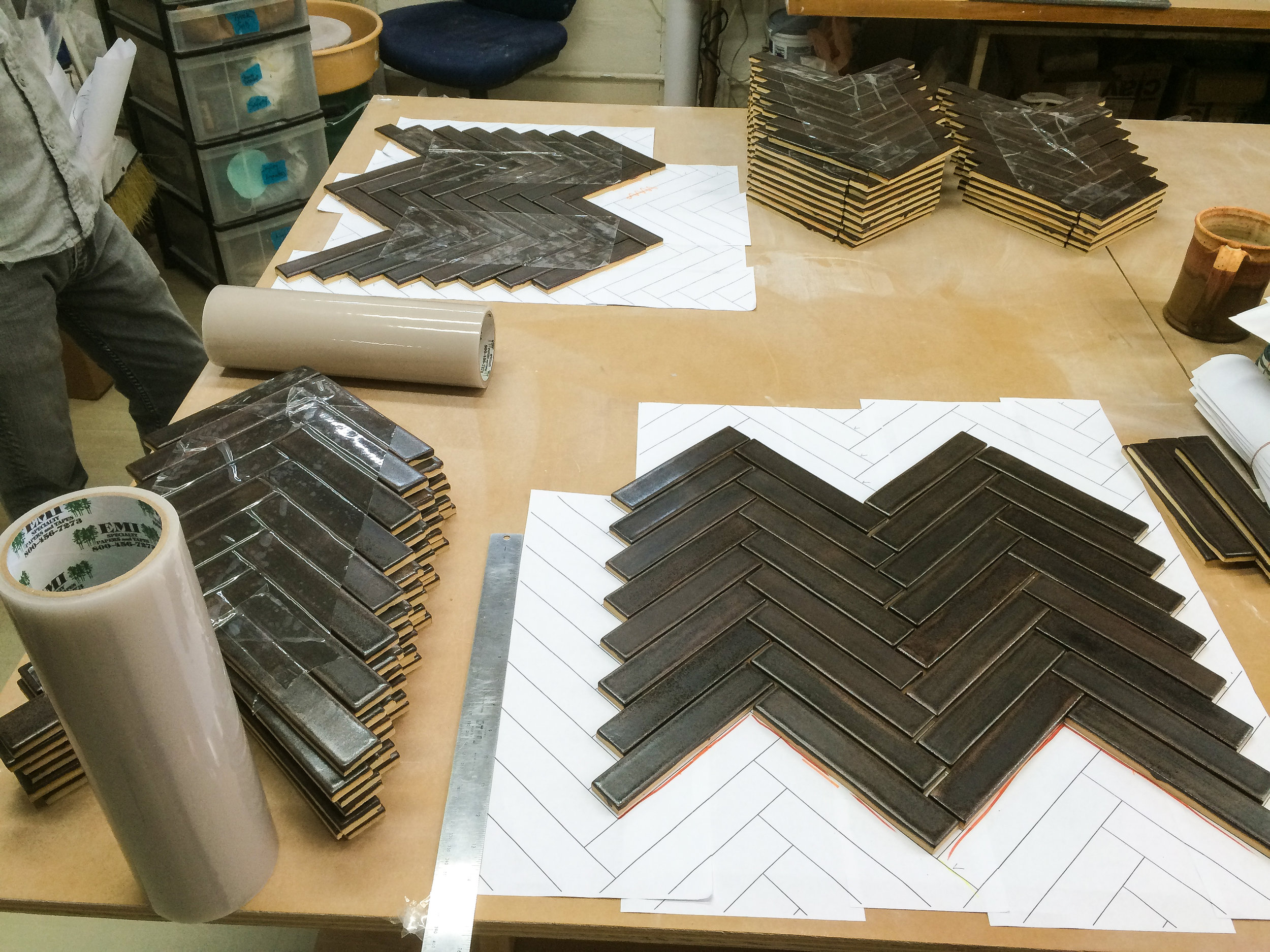 Firebox Tile packaged for shipment. Clear-face adhesive tape holds individual tiles together.