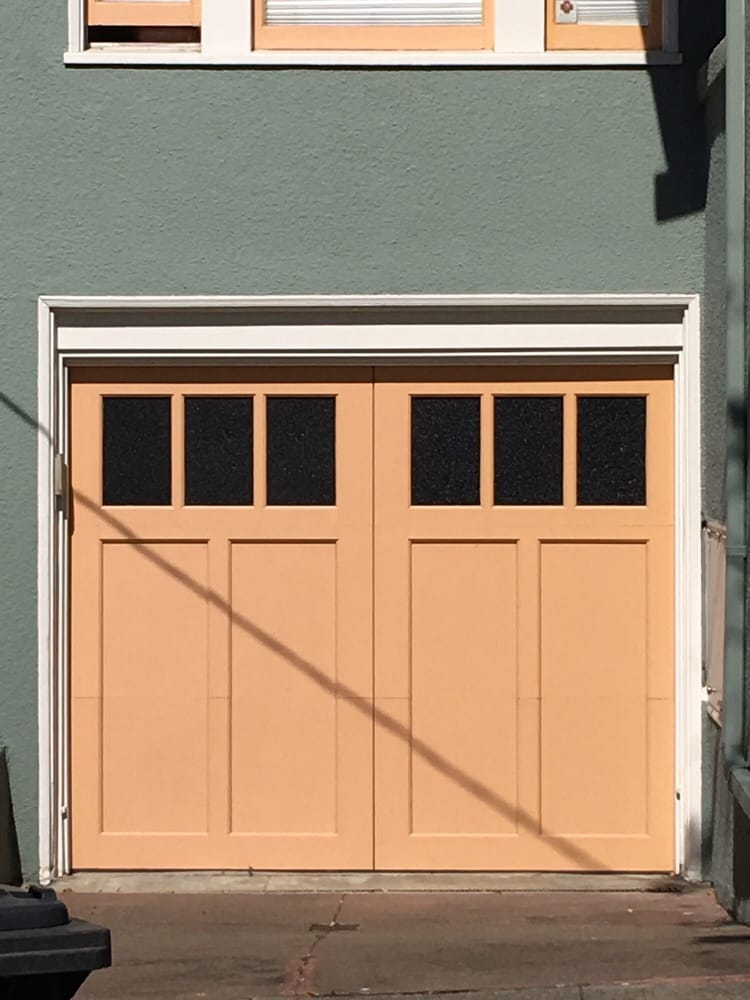 all bay garage doors - carriage house garage door - kevin chervatin - 67.jpg