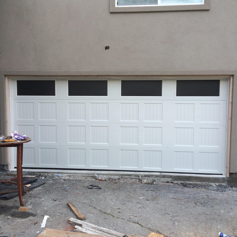 all bay garage doors - carriage house garage door - kevin chervatin - 10.jpg