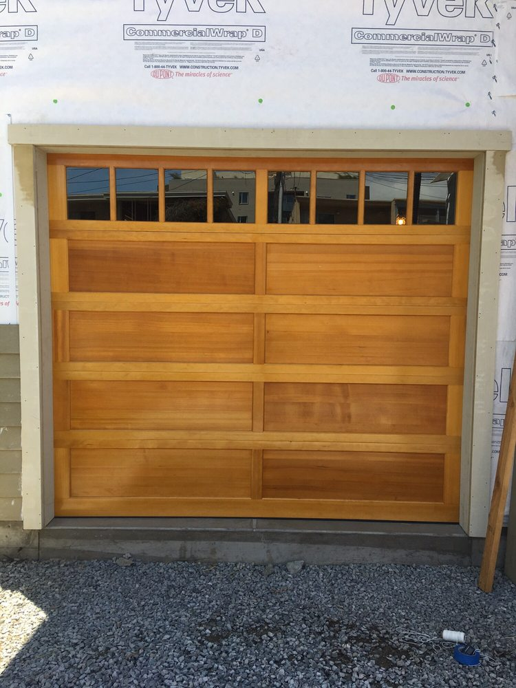 5 All Bay Garage Doors - Solid Wood Garage Doors - Kevin Chervatin - 1.jpg