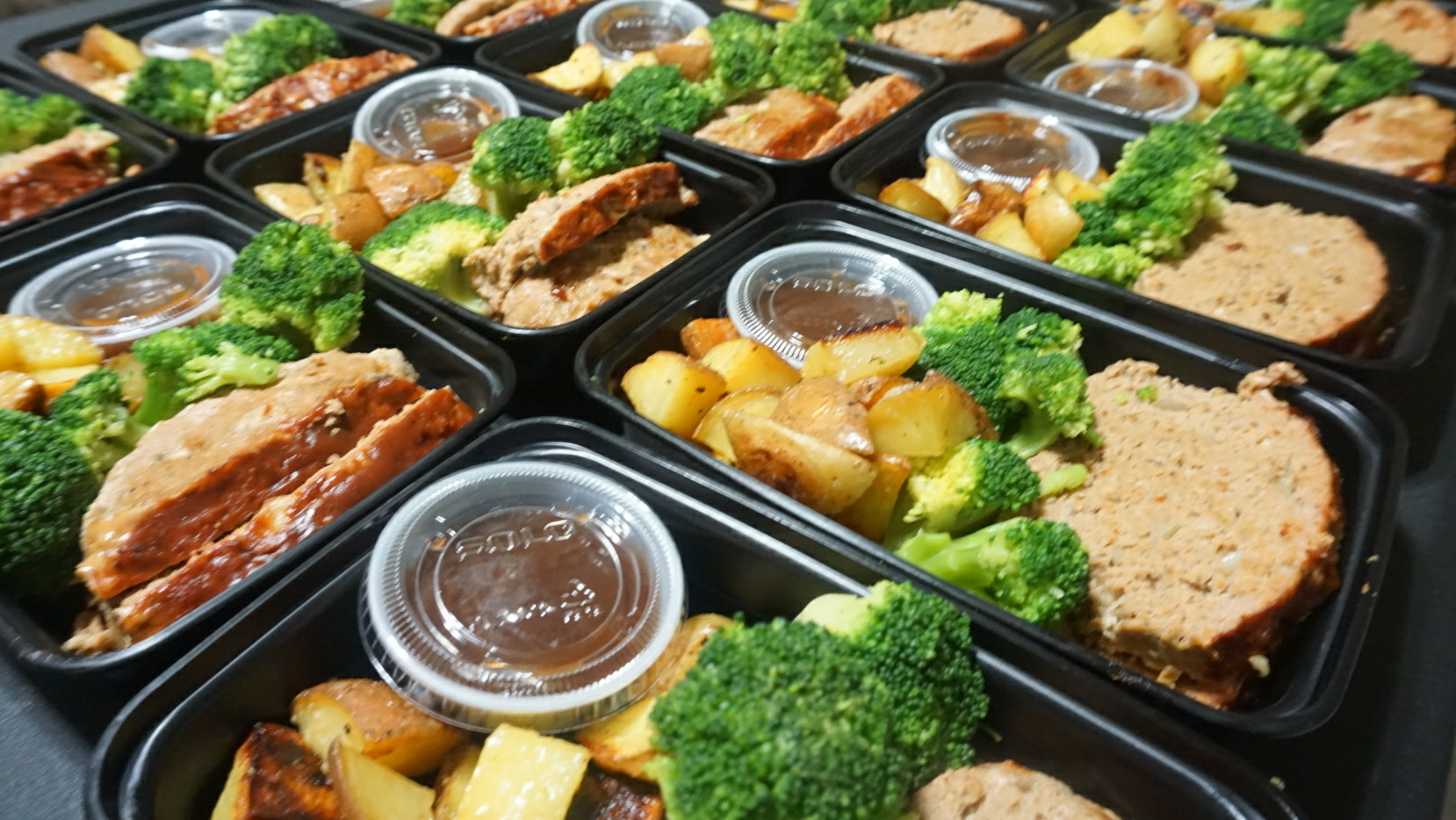 Skinny BBQ Turkey Meatloaf  Lean ground turkey meatloaf, baked with a savory low carb BBQ sauce! Comfort food without the high calories. Served with roasted potatoes and broccoli. Side of extra sugar free BBQ sauce.