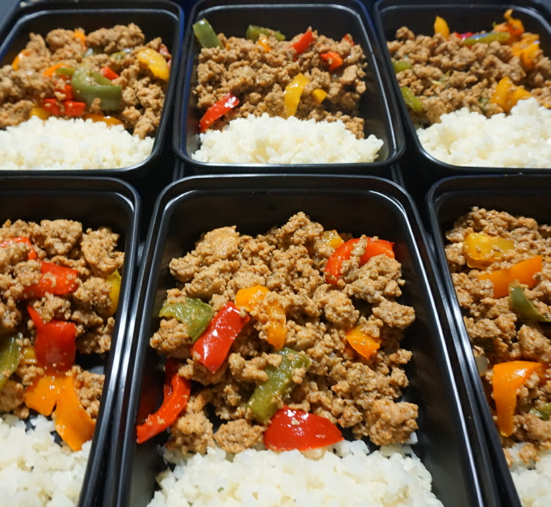 Lean Turkey Taco & Bell Peppers  Lean ground turkey mixed with small slices of bell pepper Served with brown rice and green mild sauce.