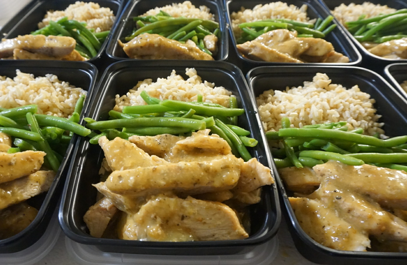 Chicken in Tomatillo Sauce  Savory, a little spicy, tangy AND creamy chicken with tomatillo sauce served with brown rice and a side of green beans