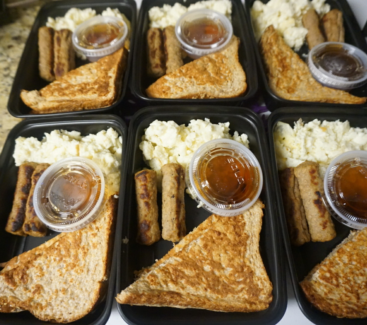 Vanilla Protein French Toast  Protein packed French Toast served with scrambled egg whites and turkey links. Served with a side of sugar free maple syrup