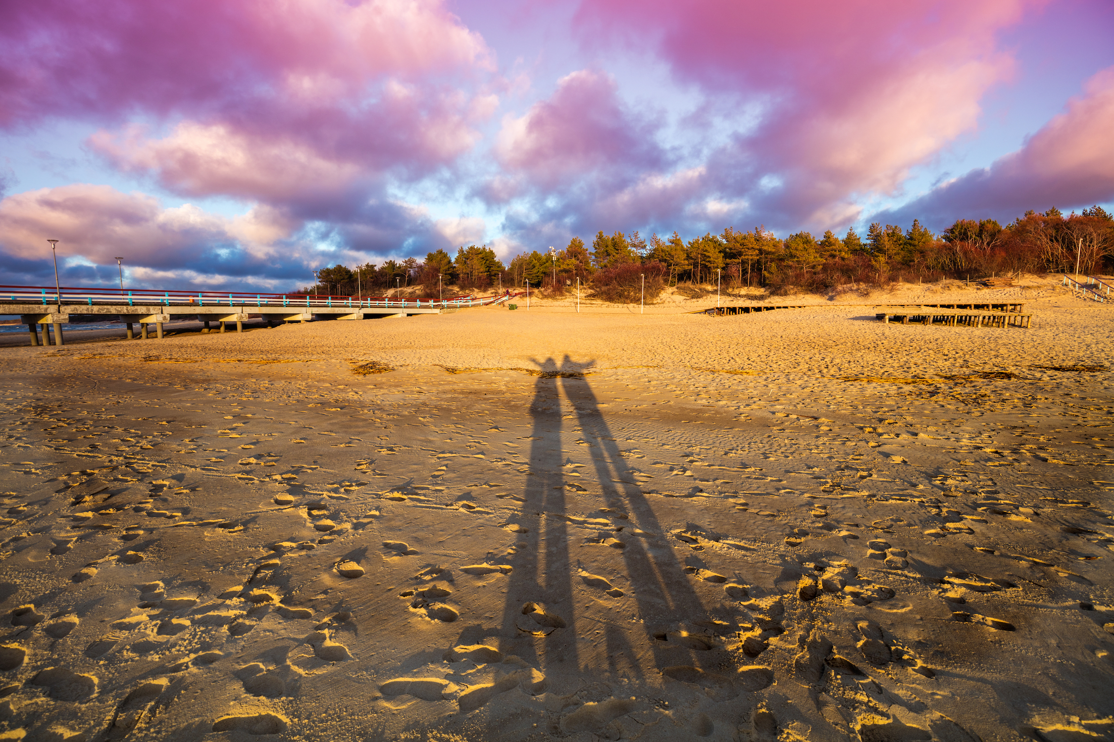 storyblocks-long-shadows-of-man-and-woman-on-the-beach-at-sunset_SRdNOWYyz.jpg