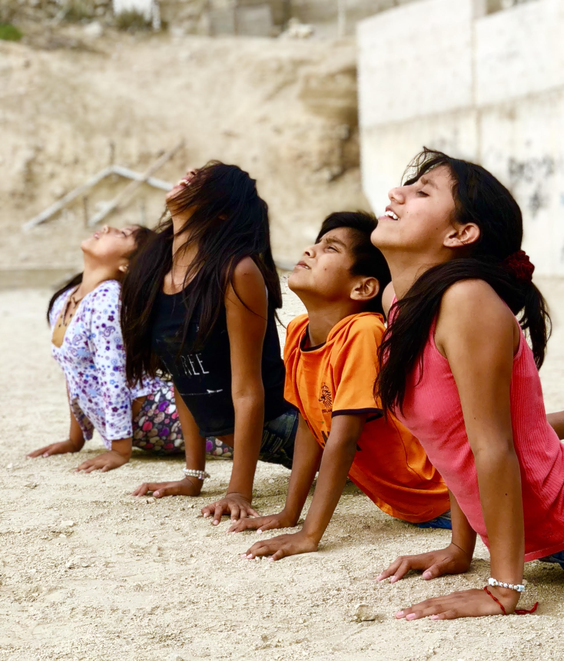 the children in Manchay doing yoga