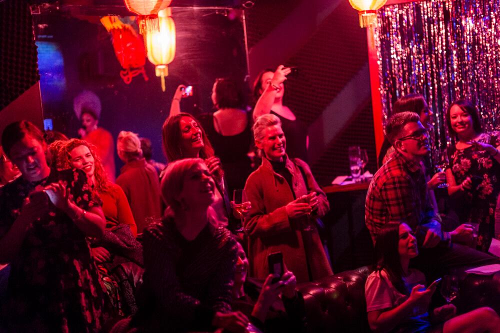 Women laughing at karaoke