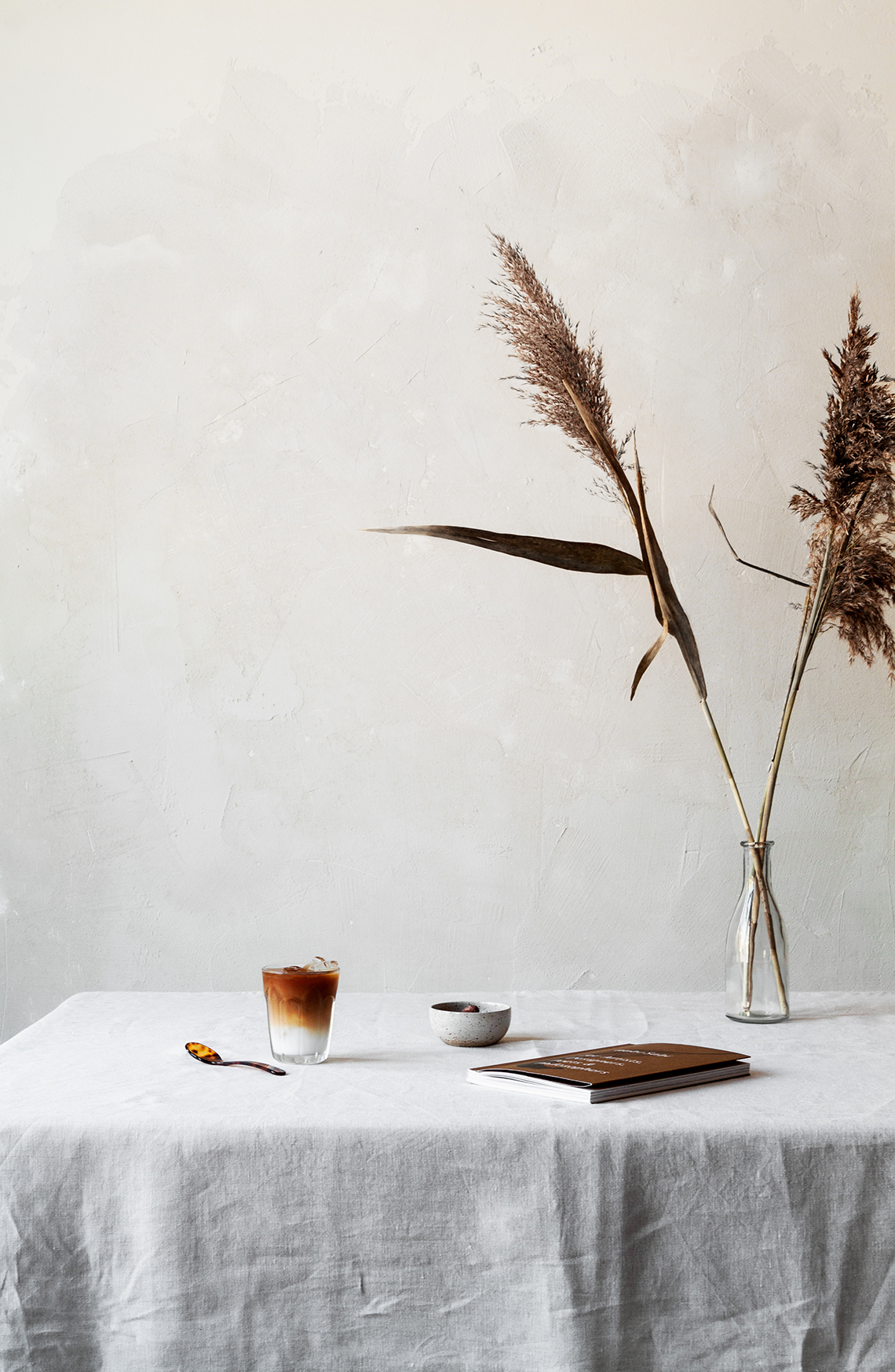 coffee setting with book and pampas grass