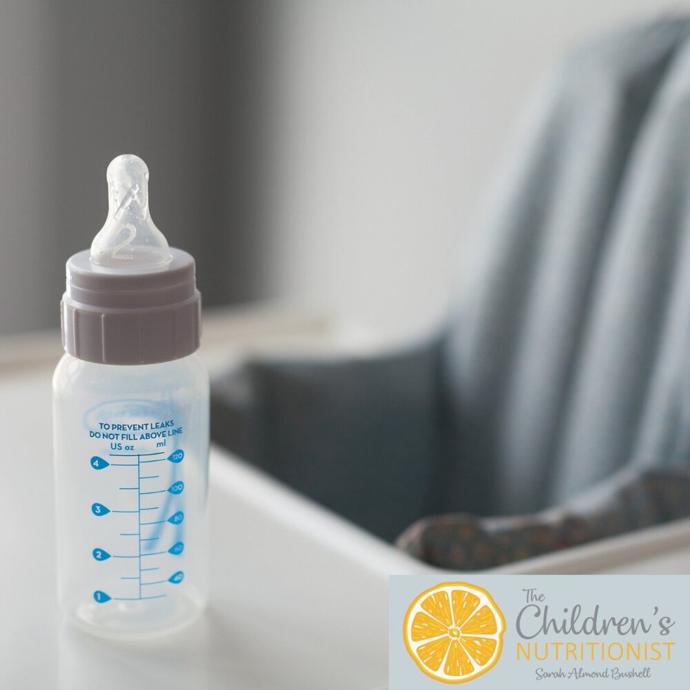 an empty baby bottle placed on a highchair