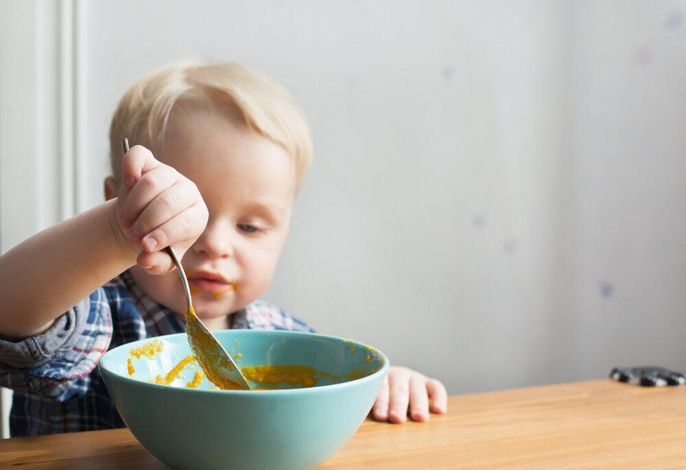 toddler eating pumpkin soup